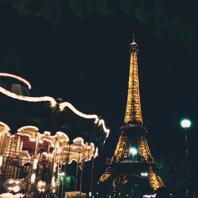 A carousel and the Eiffel Tower. Because Paris.